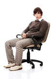 Young casual man on a chair Royalty Free Stock Photo