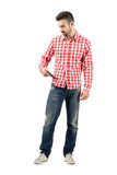 Young casual man checking smart phone from pocket Stock Image