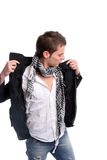 Young casual man, dressing his coat. Isolated in white background royalty free stock image