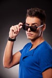 Young casual man with eyebrow raised Royalty Free Stock Images