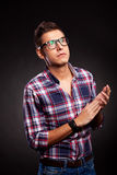 Young casual man with eyeglasses clapping Stock Image