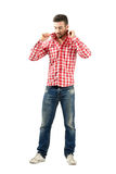 Young casual man fixing collar looking down Stock Images
