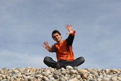 Young casual man gestures. At the beach royalty free stock photography