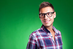 Young casual man with glasses looking away Royalty Free Stock Photos