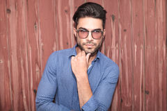 Young casual man with glasses thinking Royalty Free Stock Images