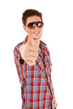 Young casual man going thumb up Royalty Free Stock Image
