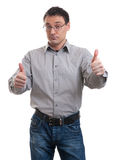 Young casual man going thumb up Royalty Free Stock Images