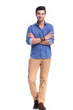 Young casual man with hands crossed smiling Stock Photos