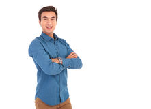 Young casual man with hands folded posing Stock Photos