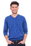 Young casual man with hands in pockets smiling Royalty Free Stock Image
