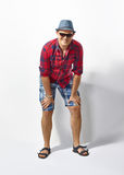 Young casual man in hat and sunglasses Stock Images