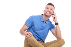 Young casual man on his phone Royalty Free Stock Photos