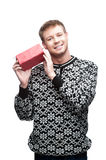 Young casual man hoding christmas gift Royalty Free Stock Images