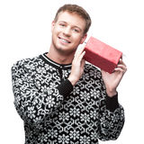 Young casual man hoding christmas gift Stock Photos