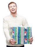 Young casual man hoding christmas gift Stock Photo