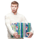 Young casual man hoding christmas gift Stock Images