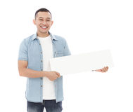 Young casual man holding blank white board Stock Photo