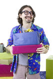 Young casual man holding gifts. Isolated Stock Images