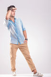 Young casual man holding his hand to the forehead Stock Images