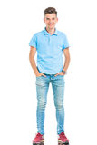 Young casual man holding his hands in pockets Royalty Free Stock Photography