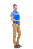 Young casual man holds his clipboard Royalty Free Stock Photography