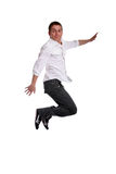 Young casual man jumping. Isolated in white royalty free stock photos