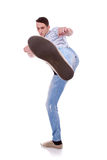 Young casual man kicking Stock Image
