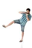 Young casual man kicking. Stock Photo