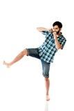 Young casual man kicking. royalty free stock photo