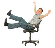 Young casual man laugh sits on chair Royalty Free Stock Photography