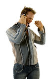 Young casual man listening music Royalty Free Stock Images