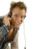 Young casual man listening music Stock Images
