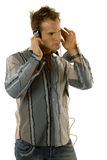 Young casual man listening music Stock Image