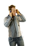 Young casual man listening music Stock Photos