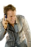 Young casual man listening music Royalty Free Stock Photography