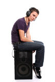 Young casual man listening to music. Isolated in white background Stock Photos
