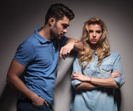 Young casual man looking at his girlfriend Stock Photos