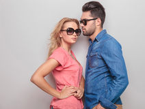Young casual man looking at his girlfriend Royalty Free Stock Image