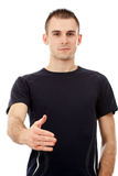 Young casual man offering to shake hands Royalty Free Stock Image