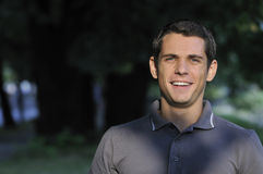 Young casual man outdoor portrait smiling Royalty Free Stock Photo