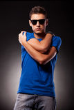 Young casual man with palms on his shoulders Royalty Free Stock Images