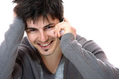 Young casual man on the phone Stock Images