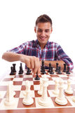Young casual man playing chess Royalty Free Stock Photo