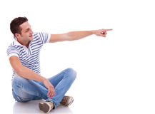 Young casual man pointing Stock Photo