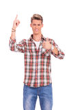 Young casual man pointing Stock Image