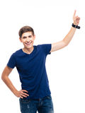 Young casual man pointing finger up Royalty Free Stock Photos