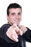 Young casual man pointing with finger at you Royalty Free Stock Photography