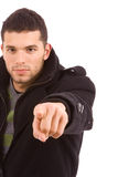 Young casual man pointing with his finger Royalty Free Stock Images