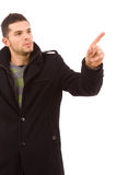 Young casual man pointing with his finger Stock Photography