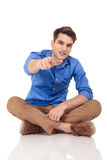 Young casual man pointing his finger at the camera. Royalty Free Stock Photography